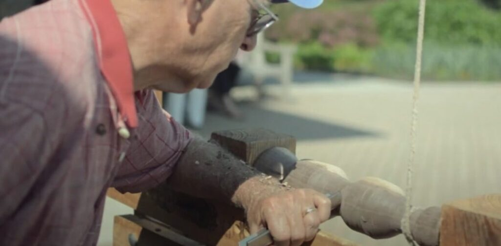 Old man working on one of the best wood lathe