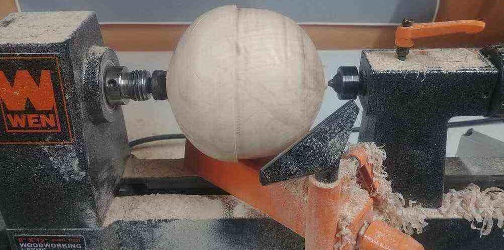 """""""A round unfinished bowl turning on a wen mini wood lathe"""""""
