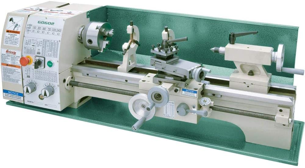 Grizzly G0766 metal lathe with green body and white bed in a white background