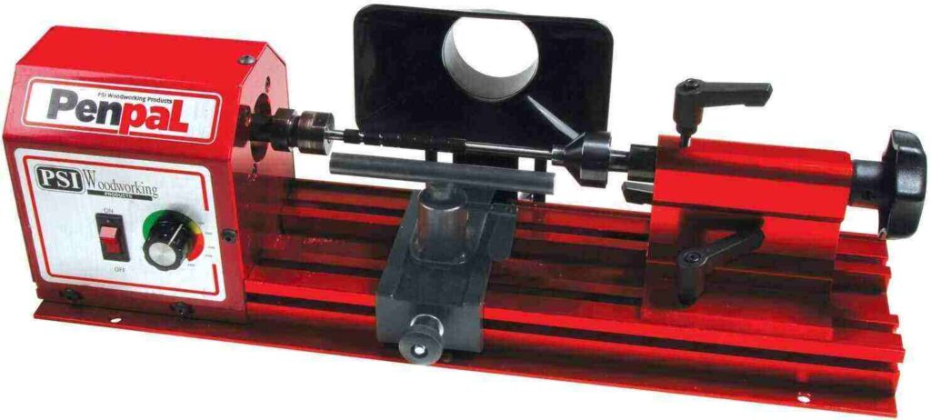 """""""Dark red colored PSI woodworking penpal mini wood lathe in a white background"""""""