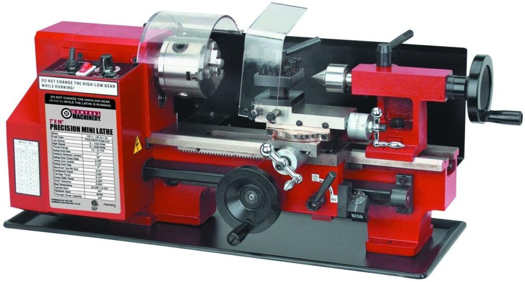 """""""Red and black colored Central Machinery 7 x 10 Precision lathe in a white background"""""""
