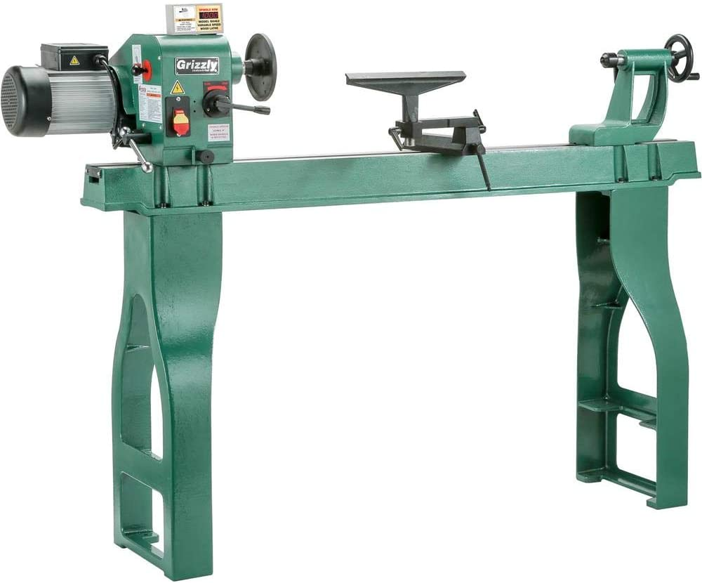 """""""Green colored Grizzly-Industrial-G0462 lathe in a white background"""""""