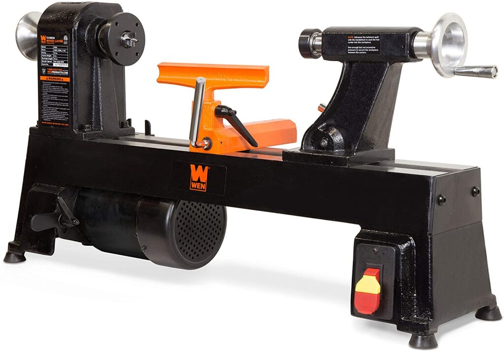 """""""3424T Midi wood lathe in a Black Colored body with orange tool rest in a white background"""""""